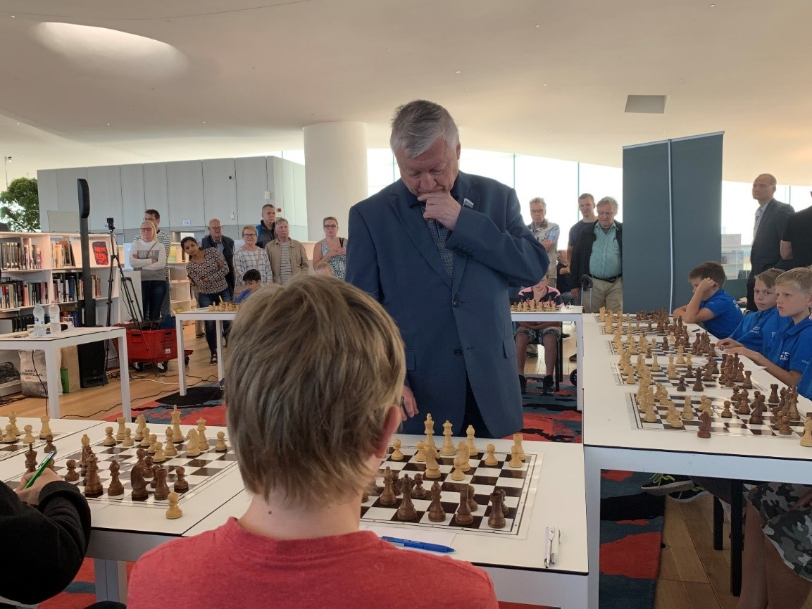 Anatoly Karpov contemplating a move against a young opponent in Helsinki, Finland.